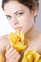 nude woman with yellow orchid