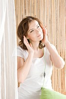 Woman listening to music on ipod