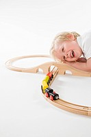 toddler boy playing with toy train set