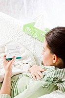 woman reading medicine label