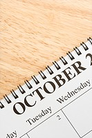 Close up of spiral bound calendar displaying month of October