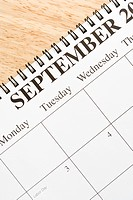 Close up of spiral bound calendar displaying month of September