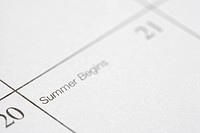 Close up of calendar displaying the beginning of summer