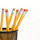 Group of pencils in a pencil holder with eraser ends up