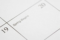Close up of calendar displaying the beginning of spring.