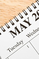 Close up of spiral bound calendar displaying month of May