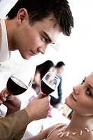 couple drinking red wine during party