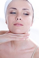 young woman massaging face