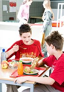 two boys eating lunch at school