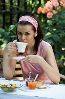 young woman drinking coffee during breakfast