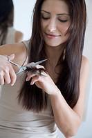 woman cutting hair endings