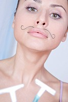 young woman with moustache and razor