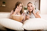 grils watching horror movie