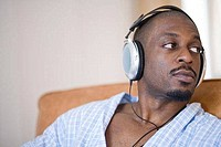 Close_up of a mid adult man listening to music