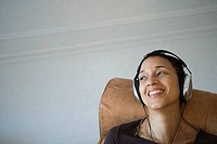 Close_up of a mature woman listening to music