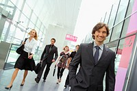 Businesspeople walking in conference center