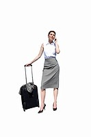 Businesswoman with luggage on mobile phone, cut out (thumbnail)