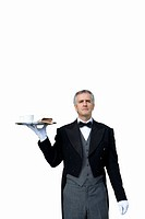 Mature butler with tray of tea, cut out (thumbnail)