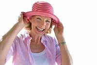Senior woman smiling, wearing sun hat, cut out (thumbnail)