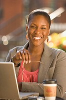 Smiling African businesswoman working outdoors