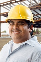 Hispanic man in hard hat on construction site