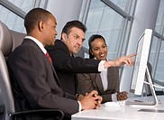 Business people looking at computer monitor