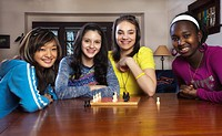Teenage girls playing chess