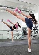 Hispanic woman kick boxing in health club (thumbnail)