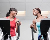 African women using exercise equipment in health club