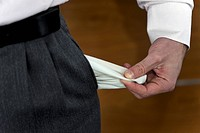 Businessman pulling out empty pocket (thumbnail)