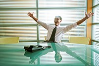 Businessman rejoicing at desk