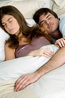 Young couple in bed sleeping (thumbnail)