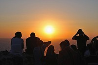Oia, people watching the famous sunset. Oia, Santorini, Cyclades, Greece, Europe