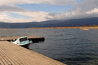 Boat moored by a small wooden dock on Vergoritis lake near Arnissa. Pella, Central Macedonia, Greece, Europe