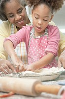 Grandmother and grandmother making a pie crust