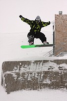 Man doing snowboarding tricks. Kellaria, Parnassos, Arachova, Viotia, Central Greece, Europe