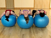 women relaxing on gym balls