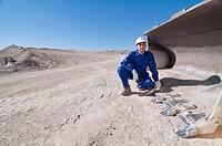 man in shovel of mining machine