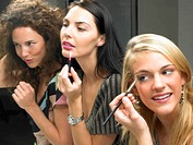 Girls applying makeup