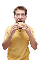 Young man eating Hamburger, portrait