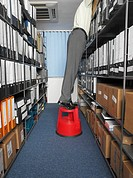 Office worker looking amongst files