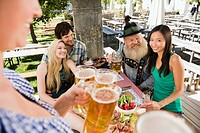 Germany, Bavaria, Upper Bavaria, People in beer garden having cold snack