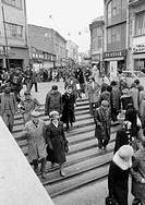 Eighties, black and white photo, people in winter clothes on shopping expedition, shopping street, pedestrian zone, stairs, Romania, Rumania, Buchares...