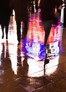 shadow people on rainy street