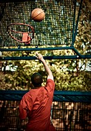 Boys playing Basketball in Training Field