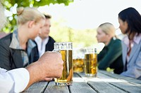 Germany, Bavaria, Upper Bavaria, Business people in beergarden