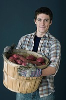Man with container of potatoes
