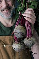 Man with beetroot