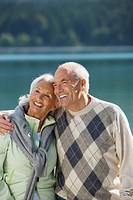 Germany, Bavaria, Walchensee, Senior couple embracing
