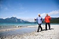 Germany, Bavaria, Walchensee, Senior couple, Nordic Walking on lakeshore